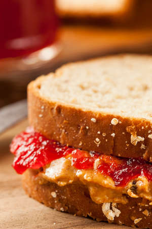 jam sandwich: Homemade Peanut Butter and Jelly Sandwich on Whole Wheat