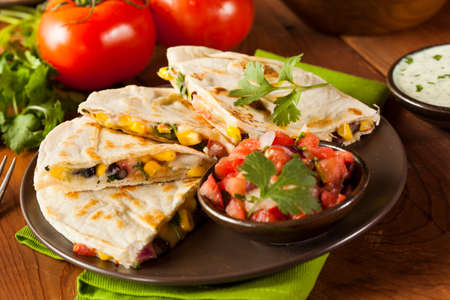 Homemade Cheese and Bean Quesadilla with Corn and Salsa photo