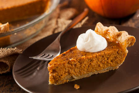 Homemade Delicious Pumpkin Pie made for Thanksgiving photo