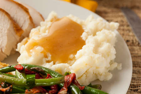 Homemade Organic Mashed Potatoes with Gravy for Thanksgiving Stock Photo