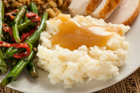 mashed potatoes: Homemade Organic Mashed Potatoes with Gravy for Thanksgiving Stock Photo