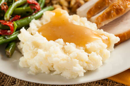 Homemade Organic Mashed Potatoes with Gravy for Thanksgiving Imagens