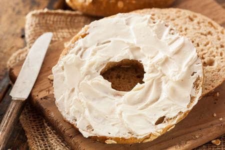 Healthy Organic Whole Grain Bagel with Cream Cheese Фото со стока