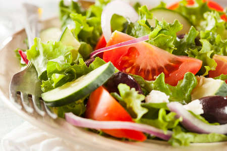 greek salad: Homemade Organic Greek Salad with Tomato, Olives, and Feta Cheese Stock Photo