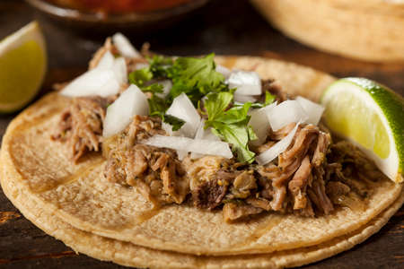 Traditional Pork Tacos with Onion, Cilantro, and Lime photo