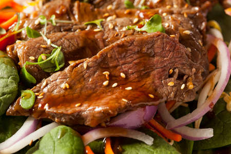 Asian Sliced Beef Salad with Spinach and Carrots photo