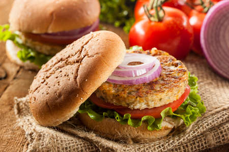 vegan food: Organic Grilled Black Bean Burger with Tomato and Lettuce