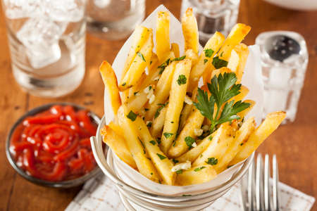 crunchy: Garlic and Parsley French Fries with Ketchup Stock Photo