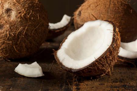 half open: Fresh Organic Brown Coconut with White Flesh Stock Photo
