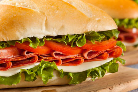 Homemade Italian Sub Sandwich with Salami, Tomato, and Lettuce Banco de Imagens - 24049034