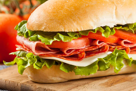 hoagie: Homemade Italian Sub Sandwich with Salami, Tomato, and Lettuce