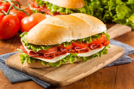 Homemade Italian Sub Sandwich with Salami, Tomato, and Lettuce photo