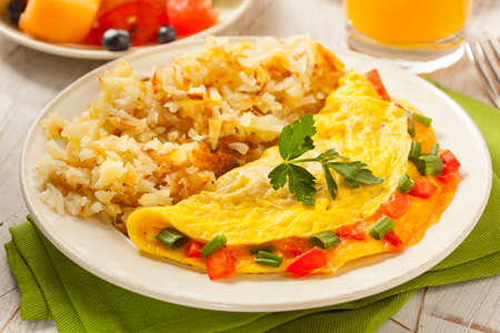 Homemade Organic Vegetarian Cheese Omelette with Onions and Peppers