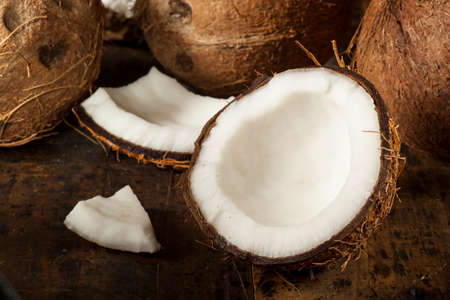 palm fruits: Fresh Organic Brown Coconut with White Flesh Stock Photo