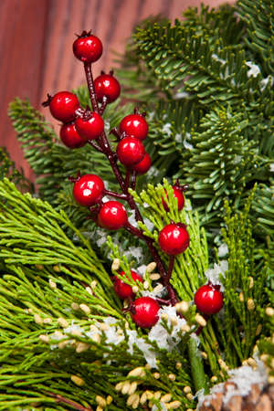 Green Holiday Christmas Decoration with Evergreen and Berries photo