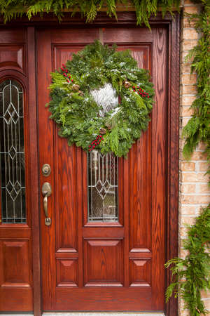 Green Holiday Christmas Wreath on a Door photo