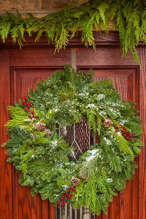 Green Holiday Christmas Wreath on a Door photo
