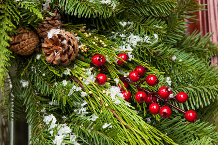 Green Holiday Christmas Decoration with Evergreen and Berries