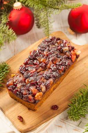Festive Homemade Holiday Fruitcake with Nuts and Seasoning photo