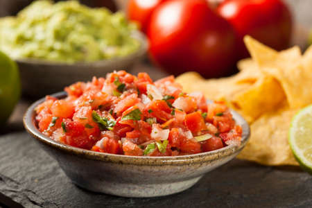 Homemade Pico De Gallo Salsa and Chips Ready to Eat photo
