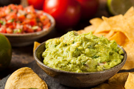 crunchy: Green Homemade Guacamole with Tortilla Chips and Salsa