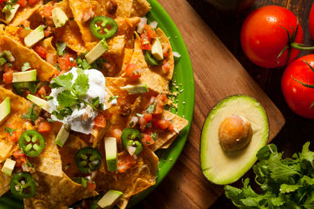 NACHO: Homemade Unhealthy Nachos with Cheese, Sour Cream, and Vegetables