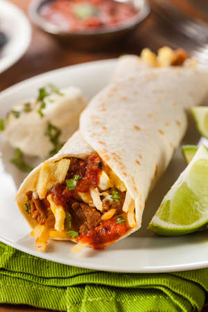 tortillas: Hearty Chorizo Breakfast Burrito with Eggs, Cheese, and Hashbrowns
