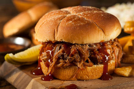 Barbeque Pulled Pork Sandwich with BBQ Sauce and Fries photo