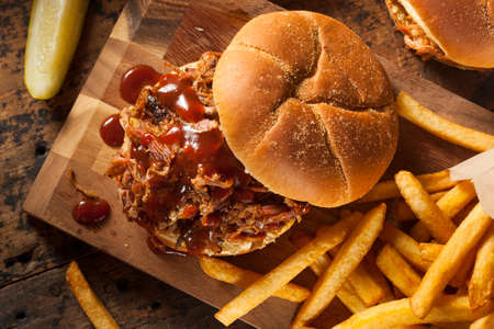 Barbeque Pulled Pork Sandwich with BBQ Sauce and Fries Stock fotó