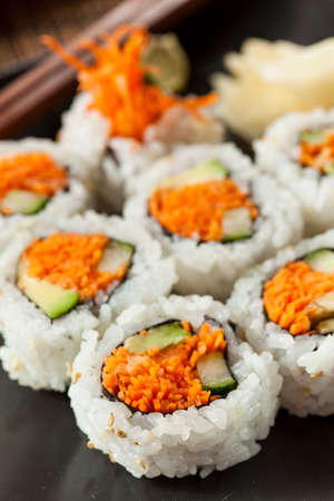 Healthy Japanese Vegetable Maki Sushi Roll with Rice and Fish Stock Photo