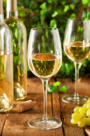 chardonnay: Refreshring White Wine in a Glass on a Background Stock Photo