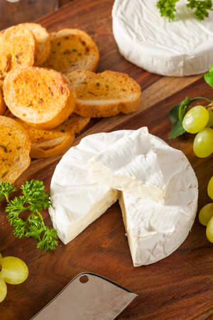Organic Homemade White Brie Cheese with Bread and Grapes
