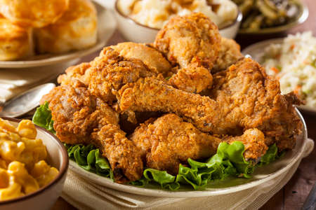 fried foods: Homemade Southern Fried Chicken with Biscuits and Mashed Potatoes  Stock Photo