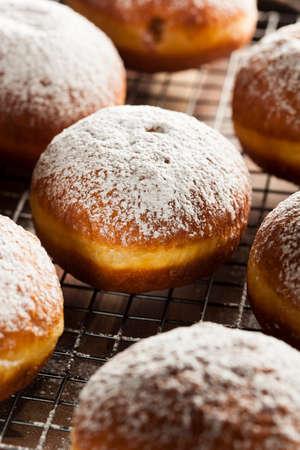 powdered sugar: Homemade Raspberry Polish Paczki Donut with Powdered Sugar