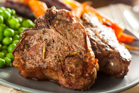 Homemade Cooked Lamb Chops with Peas and Carrots