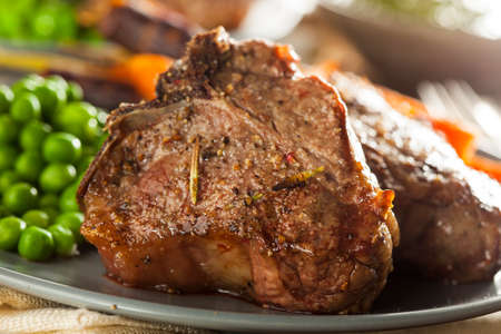 rack of lamb: Homemade Cooked Lamb Chops with Peas and Carrots
