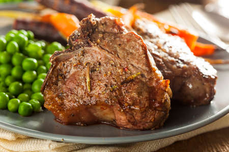lamb chop: Homemade Cooked Lamb Chops with Peas and Carrots