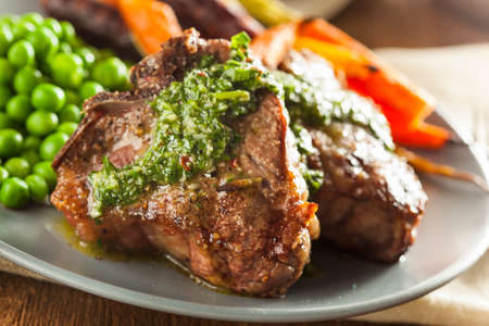 Homemade Cooked Lamb Chops with Peas and Carrots photo