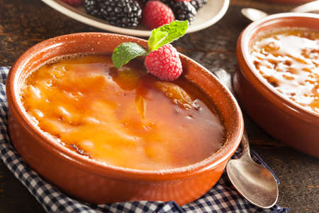brulee: Gourmet Carmelized Creme Brulee with Berries and Mint Stock Photo
