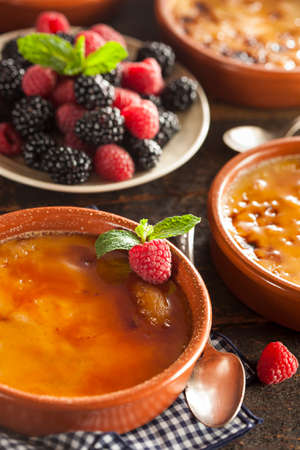 flan: Gourmet Carmelized Creme Brulee with Berries and Mint Stock Photo