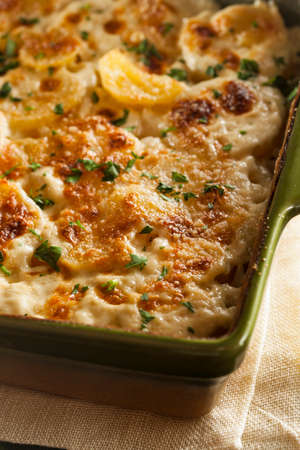 french cuisine: Homemade Cheesey Scalloped Potatoes with Parsley Flakes