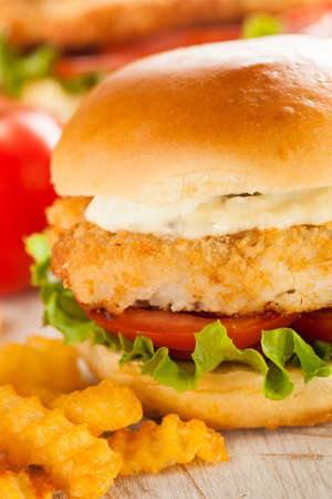 Breaded Fish Sandwich with Tartar Sauce and Fries photo