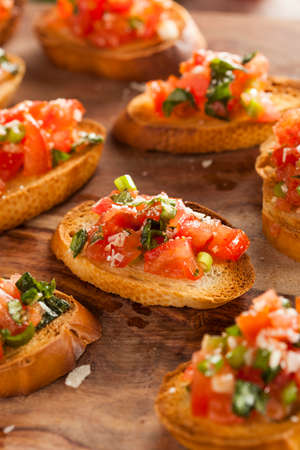 Homemade Italian Bruschetta Appetizer with Basil and Tomatoes photo