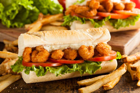 Homemade Shrimp Po Boy Sandwich with French Fries Stock Photo