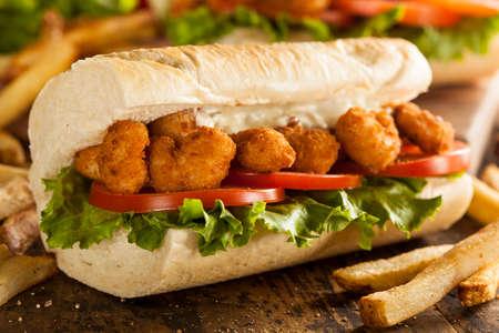 po: Homemade Shrimp Po Boy Sandwich with French Fries Stock Photo