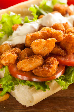 Homemade Shrimp Po Boy Sandwich with French Fries photo
