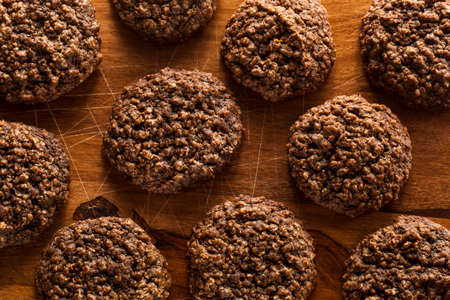 Double Chocolate Chip Oatmeal Cookies on a Cutting Board