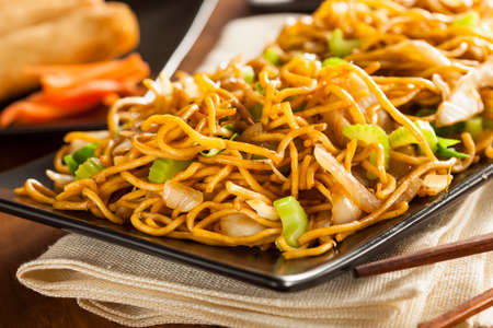 fried noodles: Asian Chow Mein Noodles with Vegetables and Chopsticks