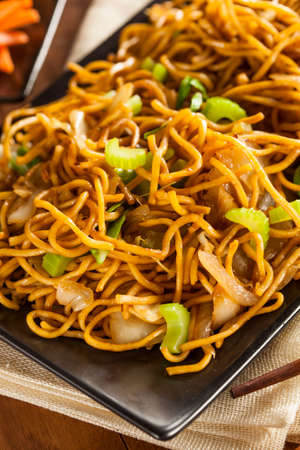 Asian Chow Mein Noodles with Vegetables and Chopsticks photo