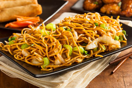 lo mein: Asian Chow Mein Noodles with Vegetables and Chopsticks